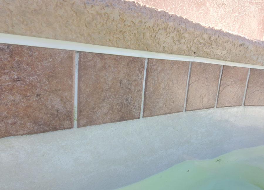 Swimming pool tile cleaned like new